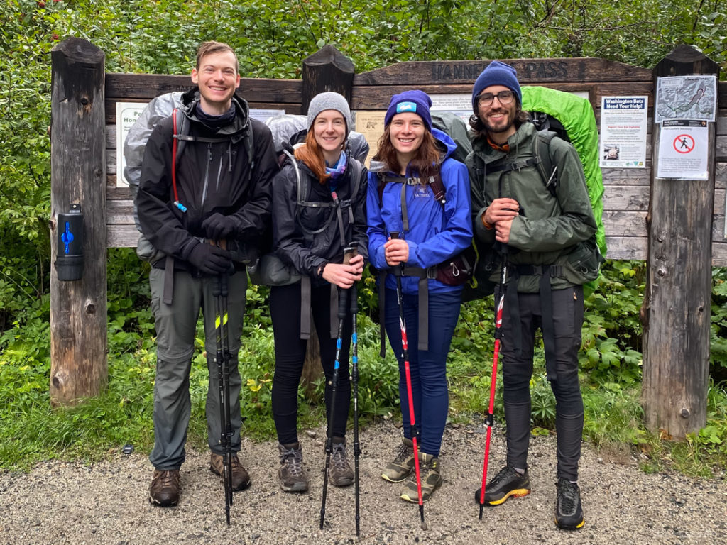 Maura, Dave, Jess, and DJ smile after completing their hike, despite the cold rain.